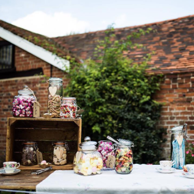 vintage sweets in jar on table and crates