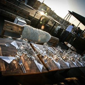 long set table on roof sun setting