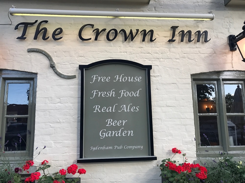 the crown inn letter on white brick wall and sign