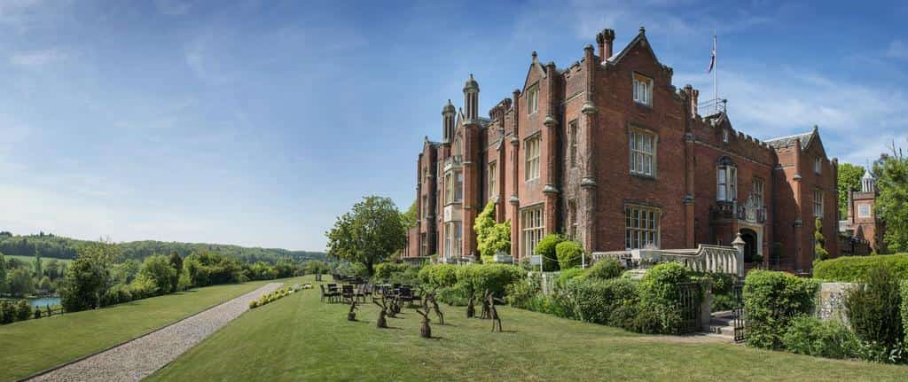 de vere Latimer hotel grand orange brick mansion blue skies cut grass