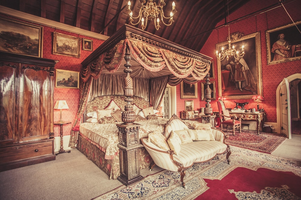 grand red and cream victorian room four posted bed with canopy