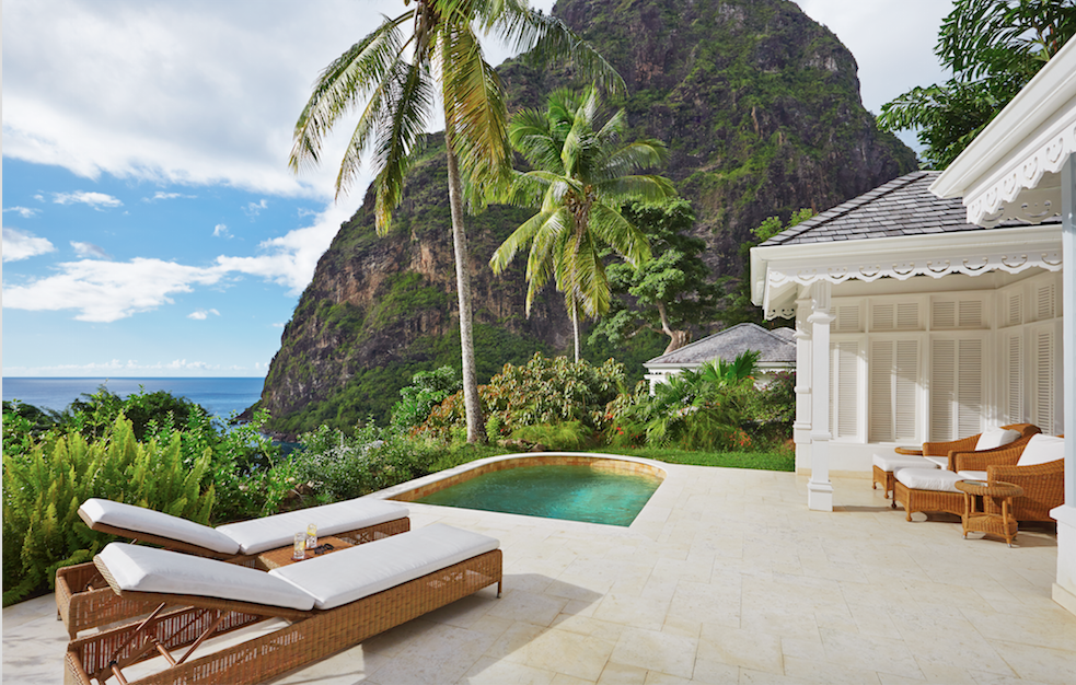 st lucia view of mountain and sea with a private pool and white sunloungers