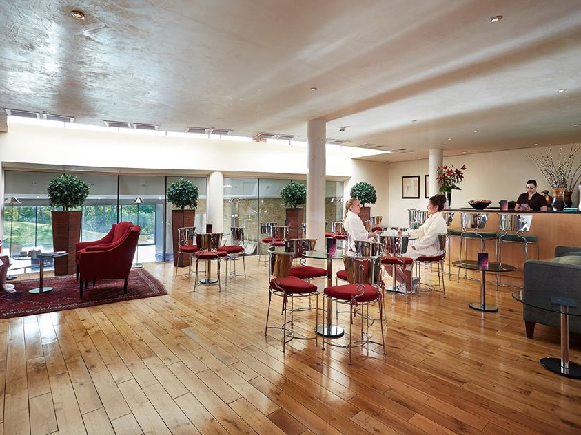 wooden floor red chairs white ceiling spa cafe
