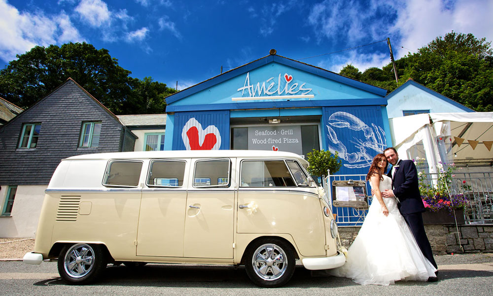 bright blue hut bride and groom standing beside cream campervan