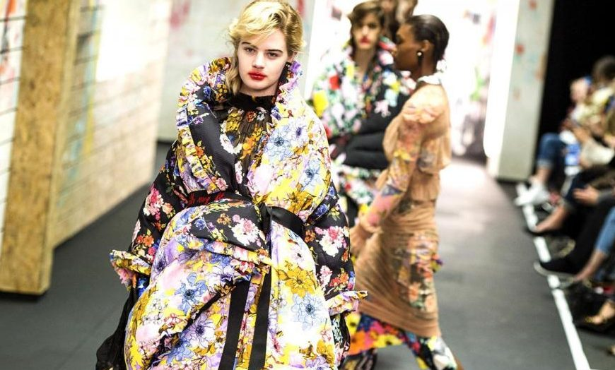 woman with smeared red lipstick in big colourful coat