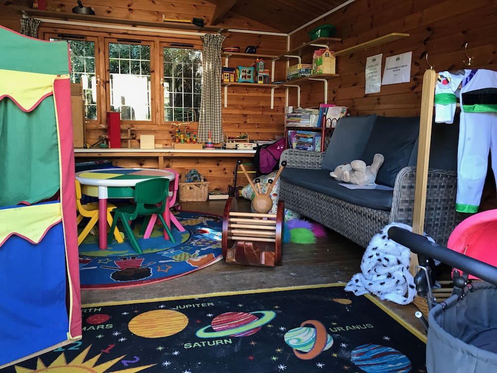 garden shed full of children toys and space scene rug