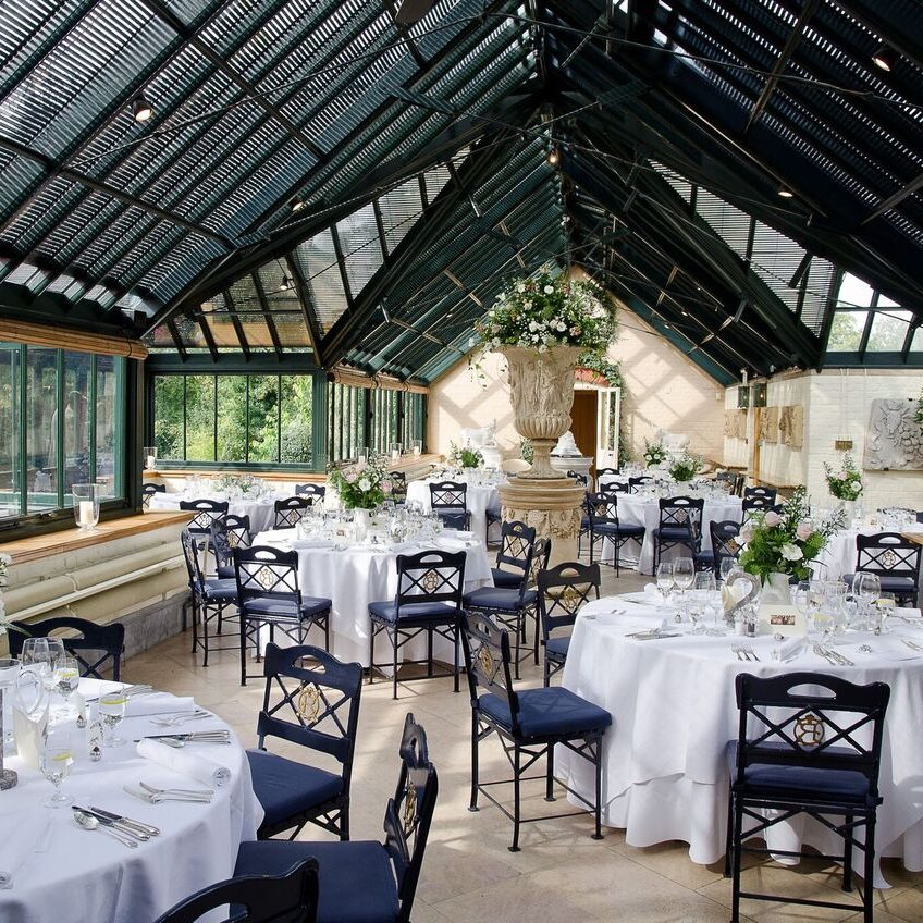 waddesdon dairy wedding reception glass ceiling white tablecloths black wire chairs
