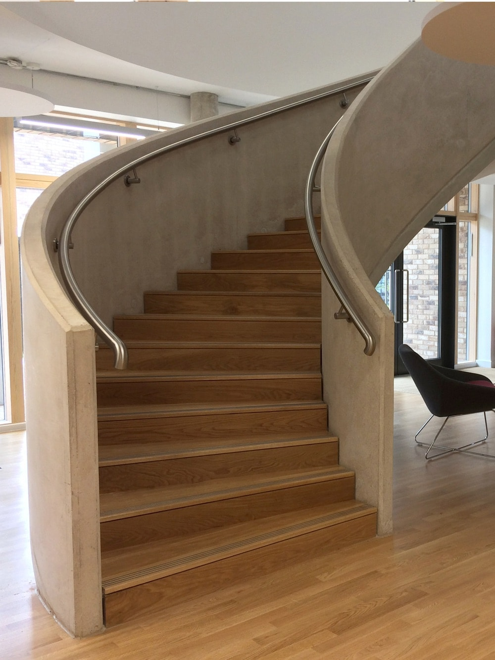 twisting stone staircase with metal ratings