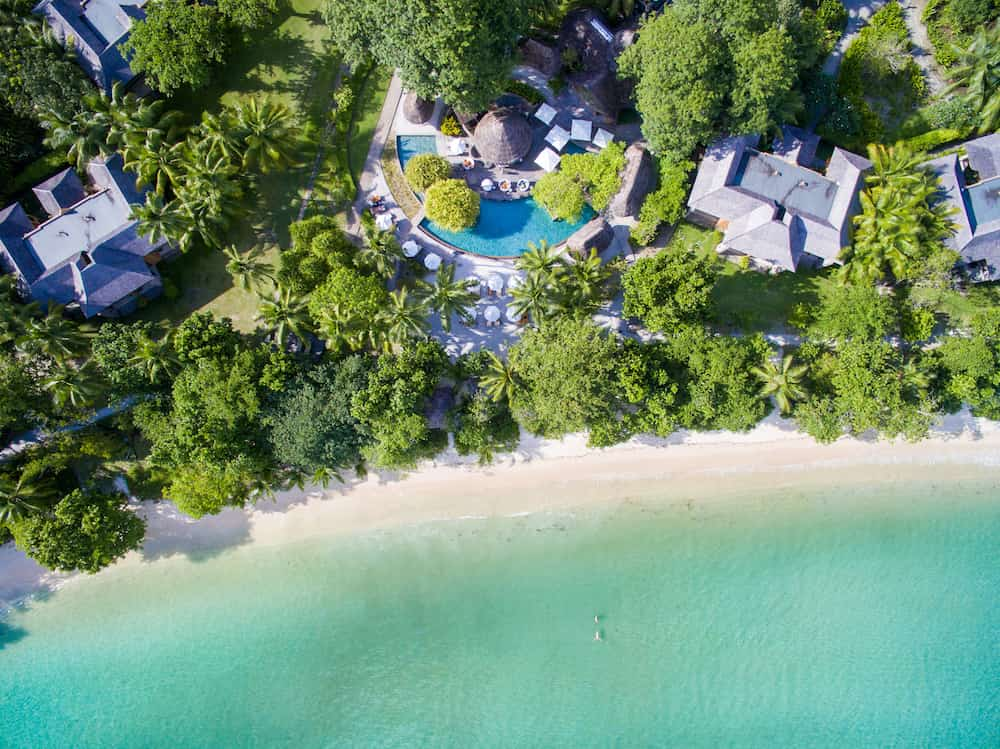 aerial view of ephelia hotel in the seychelles with white sands and turquoise waters