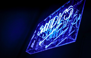 blue neon sandy's bar sign black background