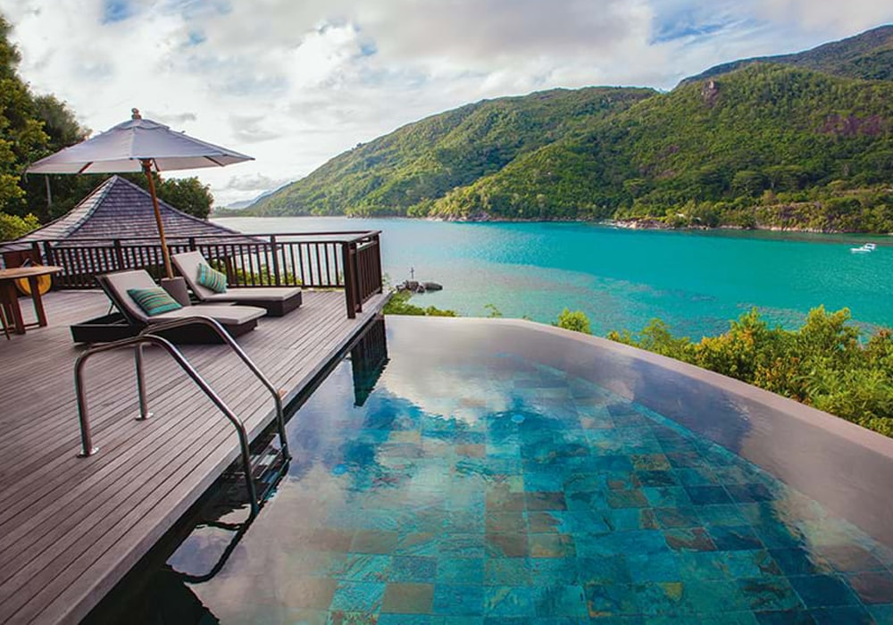 Seychelles turquoise sea pool decking sun loungers