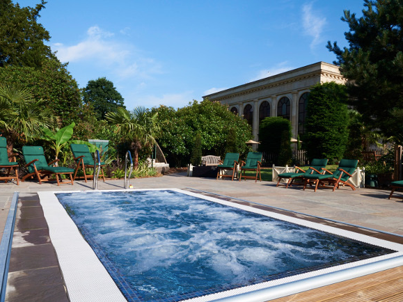 stoke park outdoor jacuzzi pool green trees stone floor