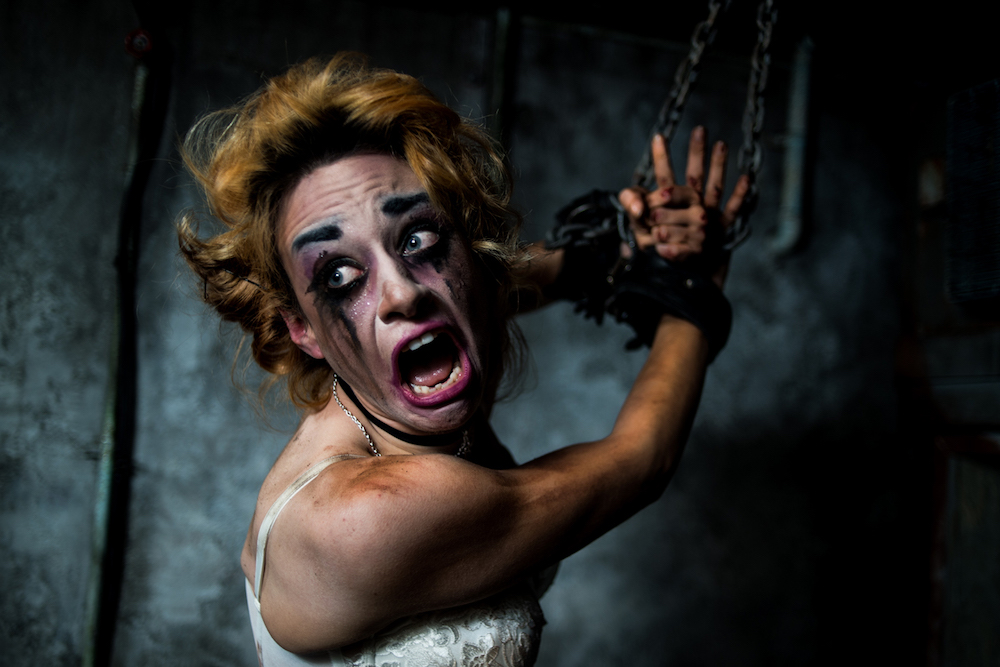 those park fright night actress screaming with make up running down face hands tied together