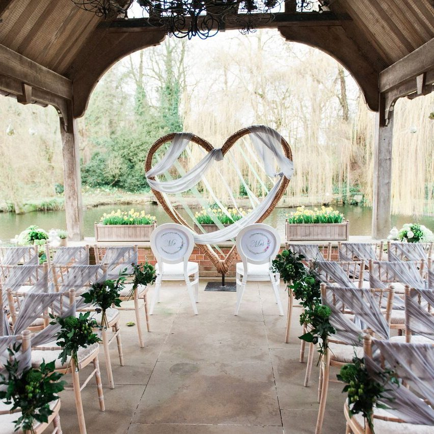 waddesdon dairy wedding ceremony by river white chairs wood giant heart