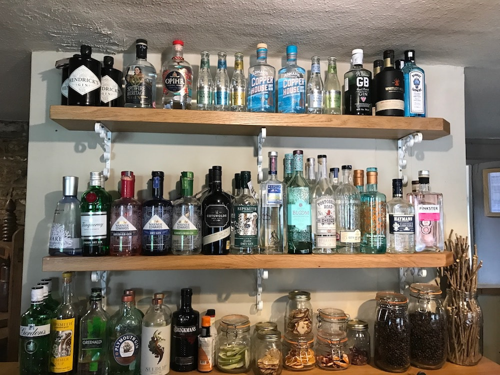 shelves of glass bottles of different artisan gins