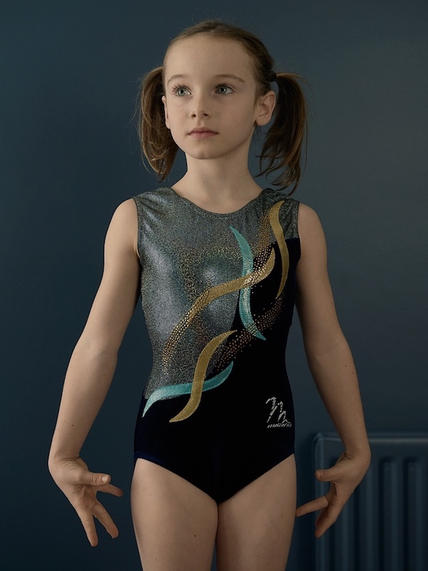 girl in pig tails and gym leotard