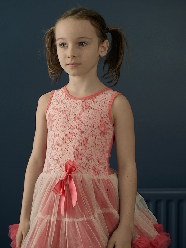girl with pig tails in pink dress