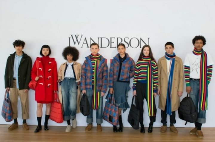 models in jw Anderson clothes leaning against white wall
