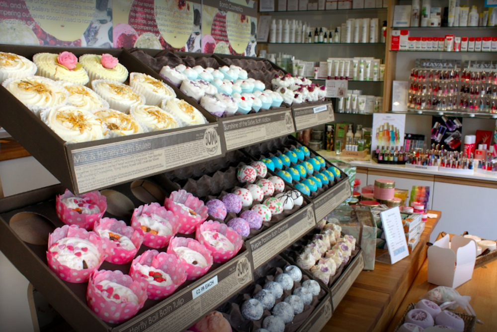shelves of multicoloured bath bombs in powder boutique