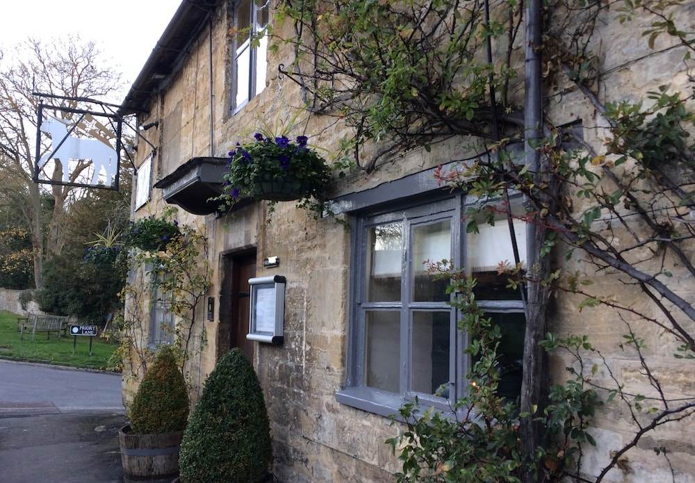 Cotswold stone inn grey painted windows