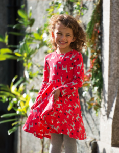 picture of little girl red dress with donkeys