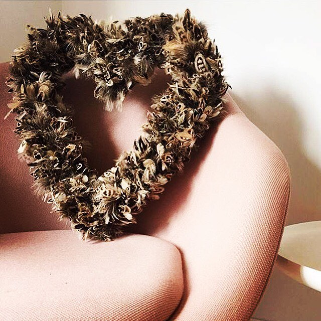 picture of heart shaped plucking wreath on seats
