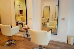 Zaneta Lichnova salon white chairs tall mirrors