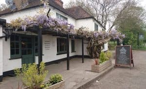 crown Farnham royal pub exterior white walls crawling vines