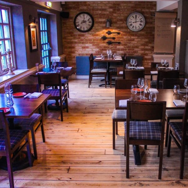 the crown farnham royal pub dinning room brick wall oak tables chairs