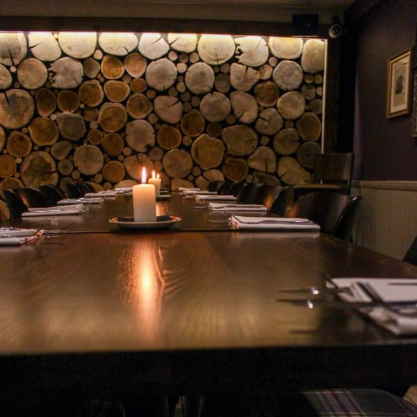 the crown Farnham royal pub dinning table lit candle log wall effect