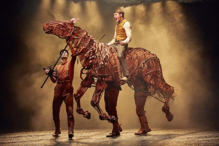 national theatre war horse production man riding life size Woden horse puppet