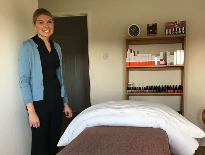 Sara Fergusson beauty therapist beauty room treatment room cream walls bed white pillow brown towel wood shelves environ products