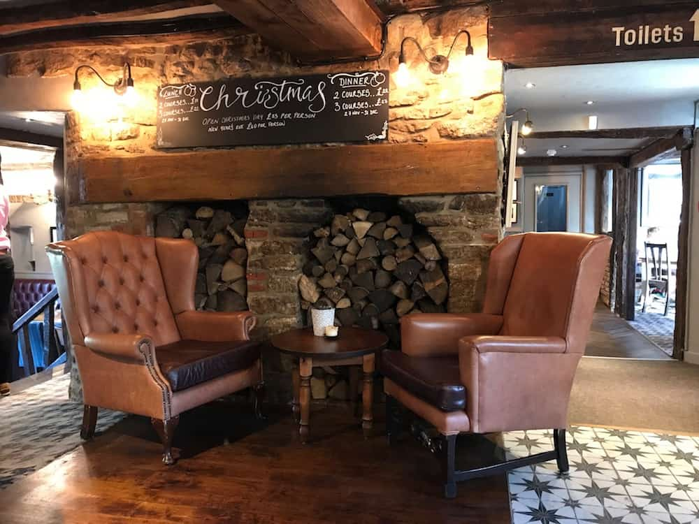 the fox interior leather chairs wooden log store chalk board