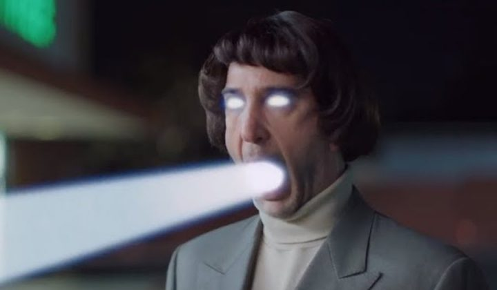david schwimmer in wig shooting laser beam out eye and mouth for Super Bowl skittles ad