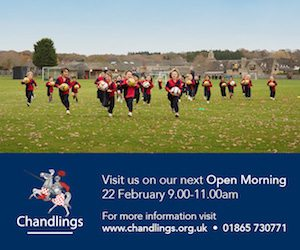 chandlings school blue web banner with children playing in field dressed in red and black
