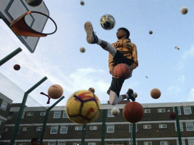 black boy playing basketball on an estate