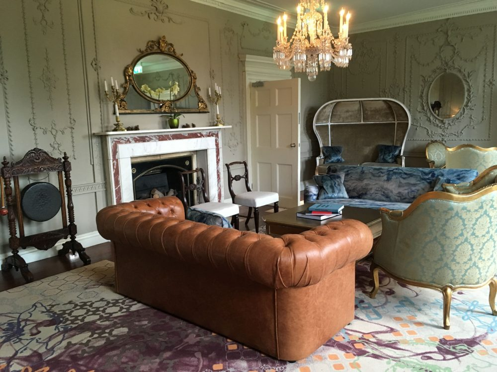 Stoke Place Drawing Room brown leather sofa fireplace mirror interior