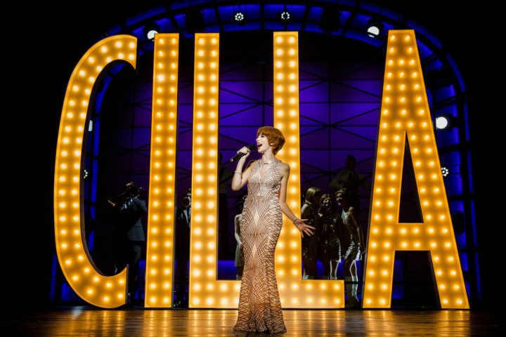 Cilla musical woman singing on stage