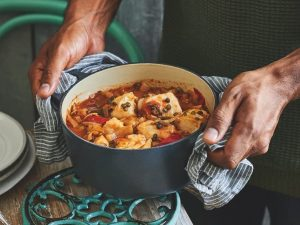 cod one pot dish food cooking hands