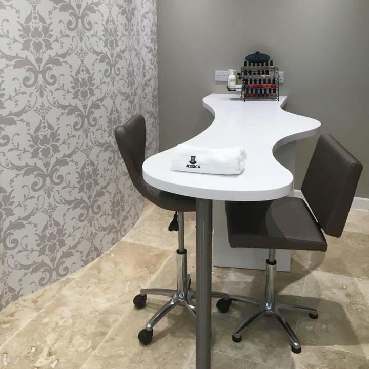 hidden secret nail bar interior table and black chairs