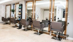 hidden secret salon interior grey chairs mirrors