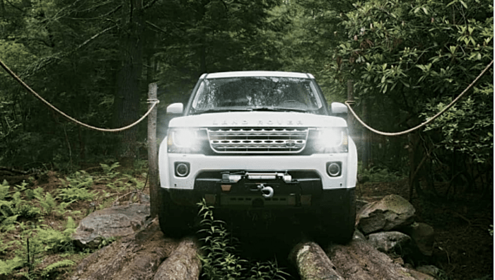 landrover logs lights on forest