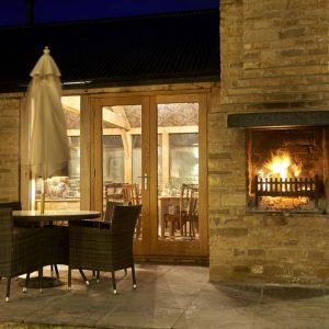 lion bicester pub outside fireplace table chairs