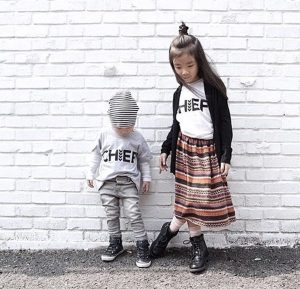 lovely stuff children in front of white brick wall girl and boy children's clothes