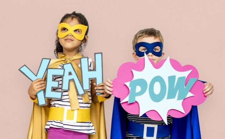 superhero oxford science children in costumes with sign yeah pow masks