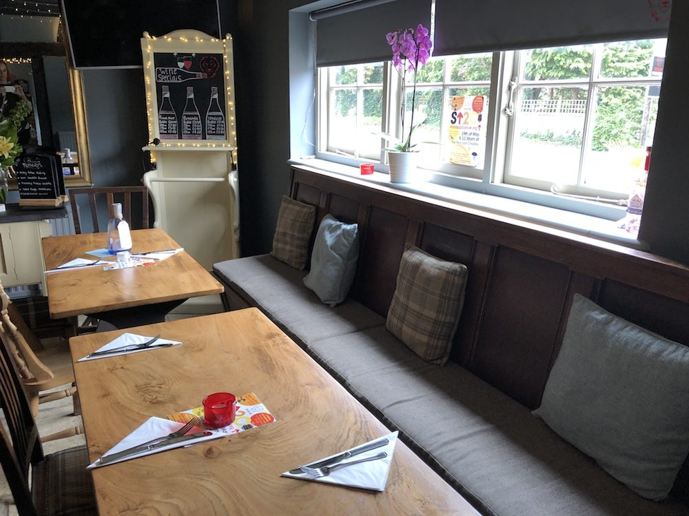 Red Lion Cholsey interior tables banquette cushions seating