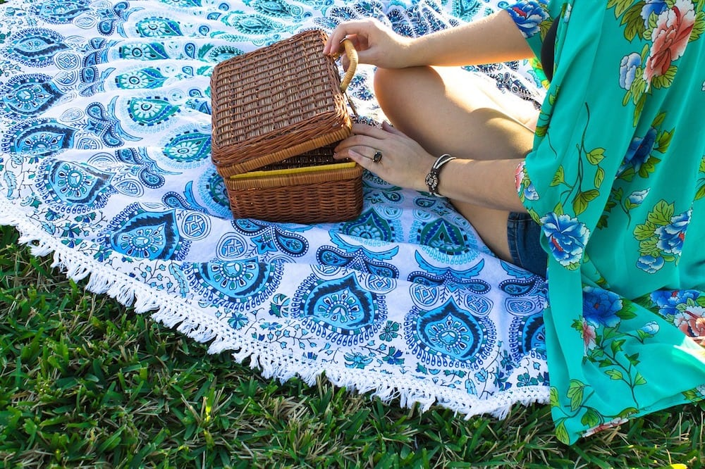 picnic basket being opened by woman