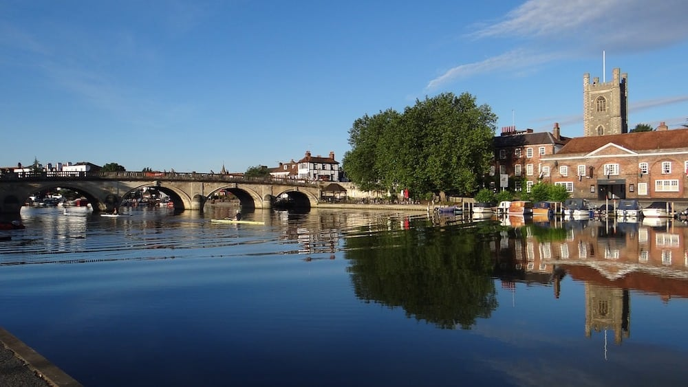 river and bridge in the sunshine with Henley church in the right of the image