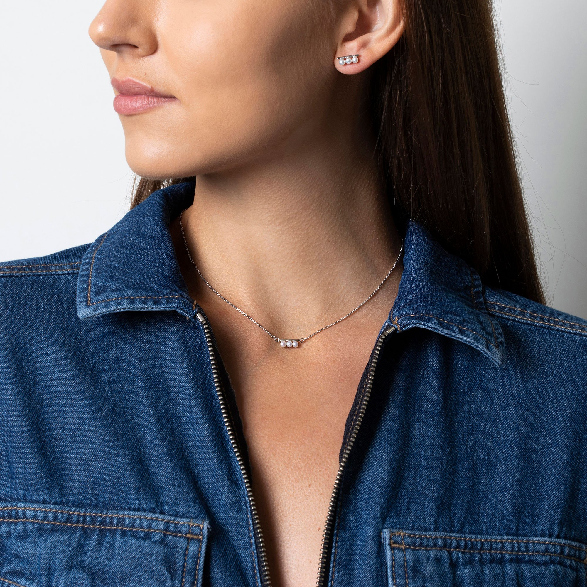 Lady wearing Claudia Bradby earrings and necklace