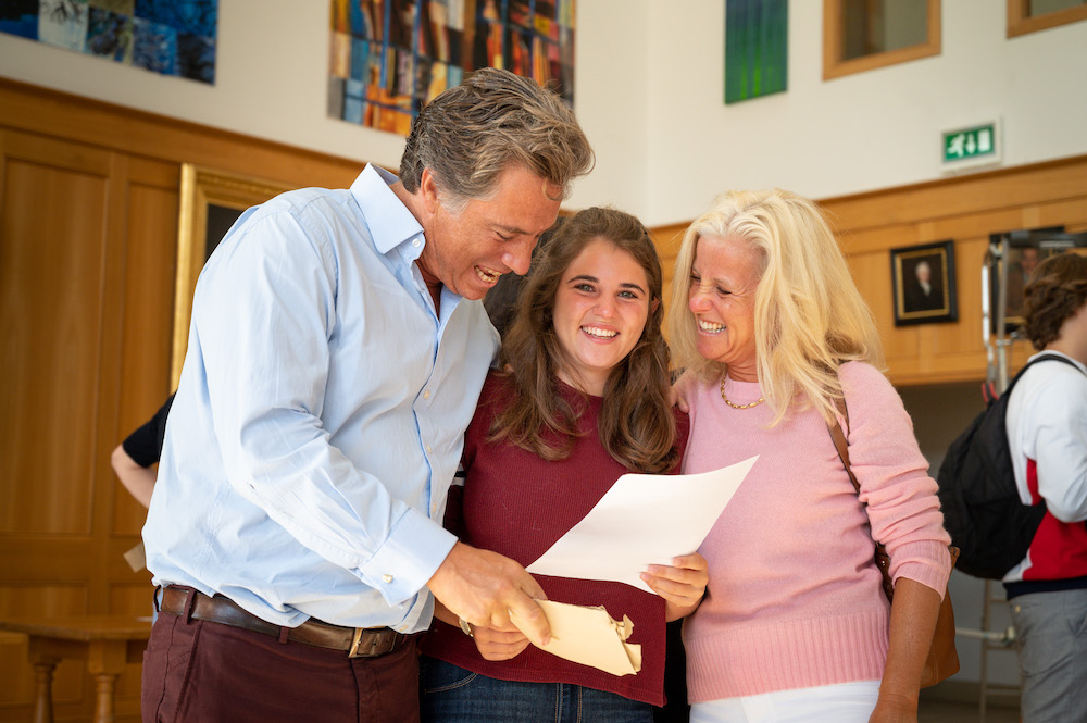 Pupil getting results with her family
